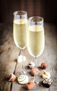 Two glasses of champagne with luxury candies ** Note: Shallow depth of field