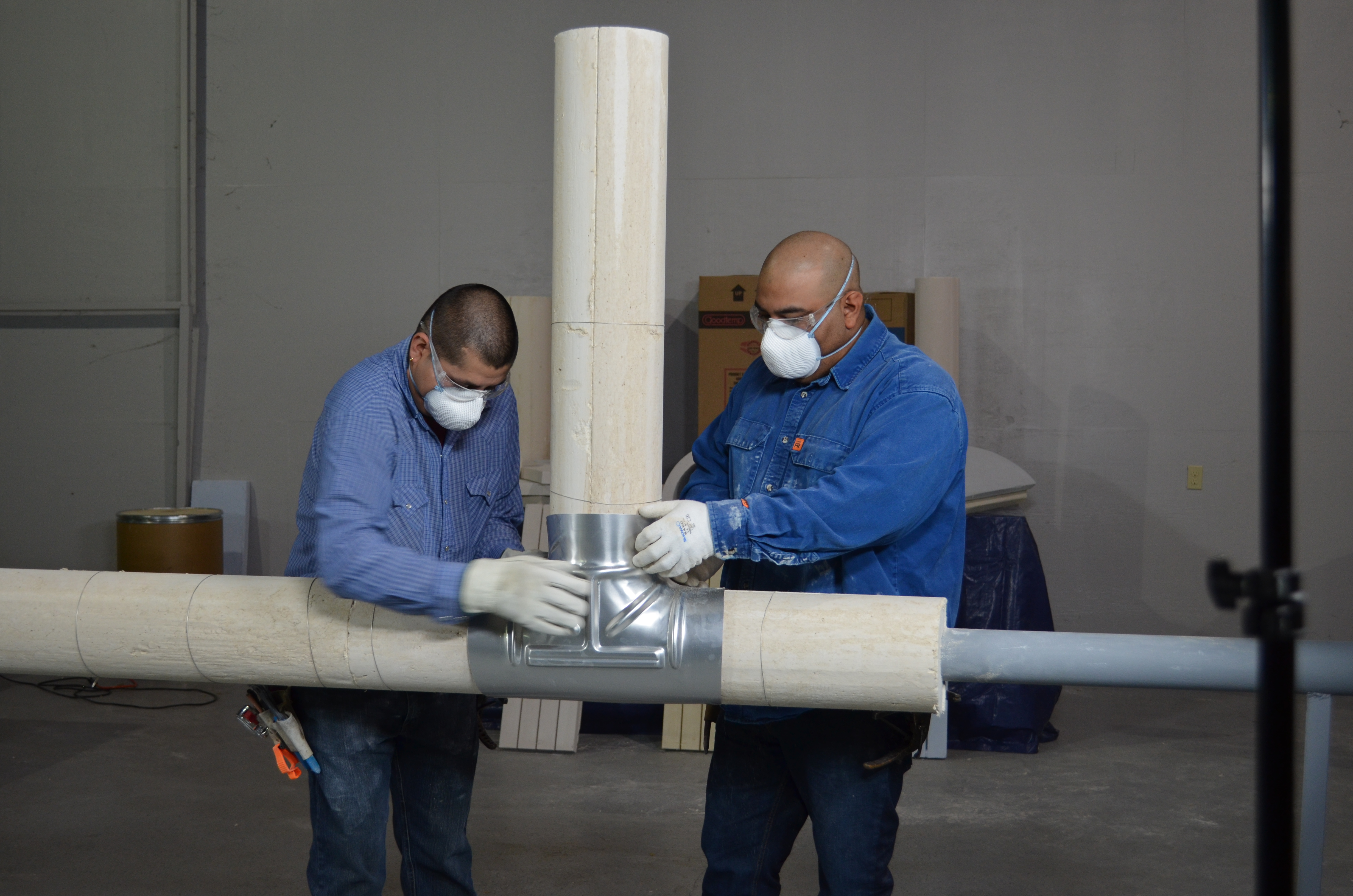 Two insulators installing Calcium Silicate-Perlite with Metal Jacketing at the T-junction